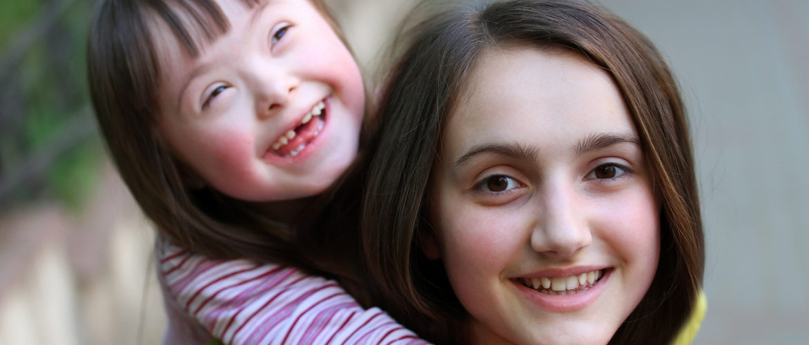 Happy family moments - A child and her younger sister have a fun.