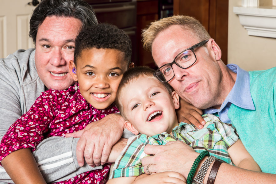 Gay parents and their children pose for a photo
